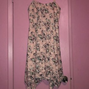 Women's soft pink floral dress with open back